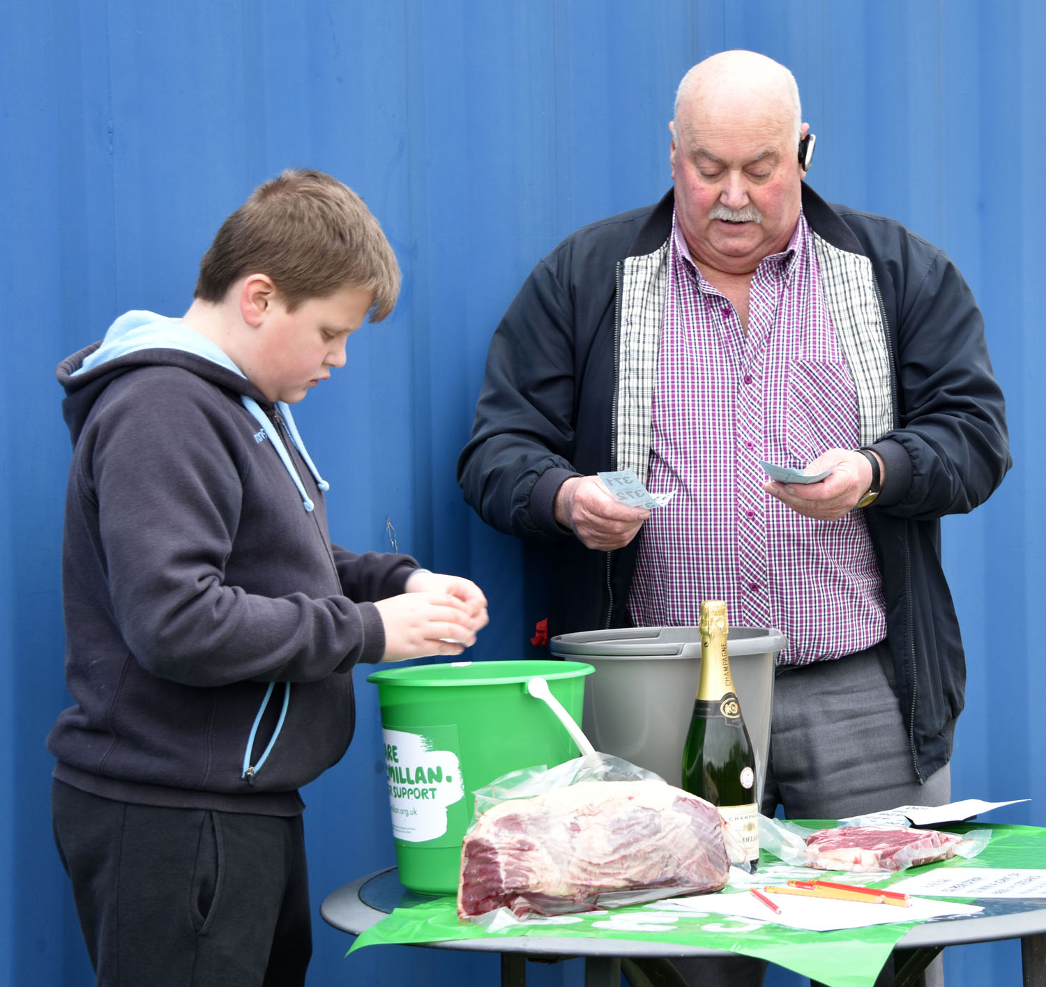 Lewis and Grandad Andy draw the raffle